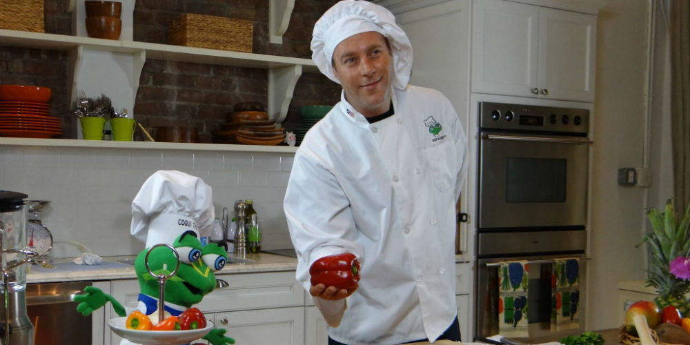 Coqui the Chef puppet mascot