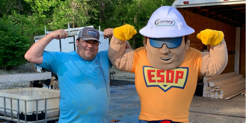 ESOP man mascot posing with employee-owner