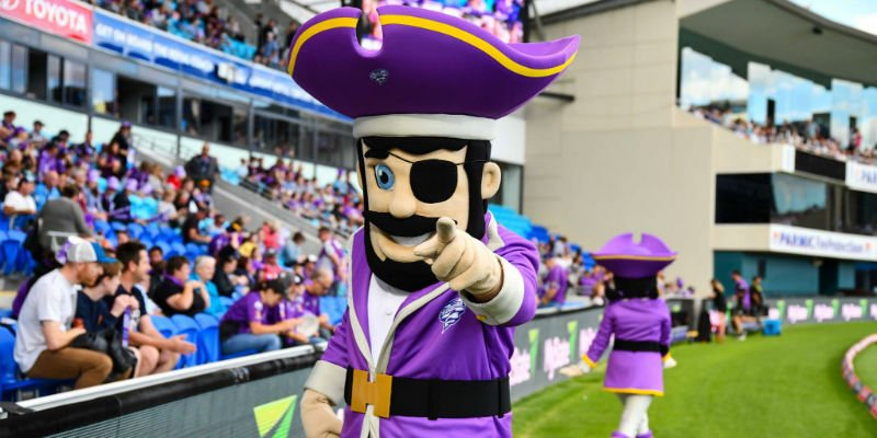 A pirate mascot pointing at the crowd