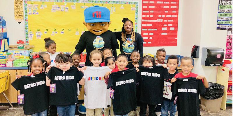 Astro Kidd mascot with local school children