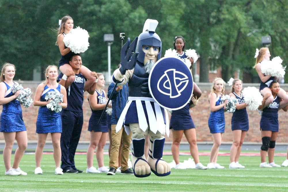 Mascot performing with cheerleaders