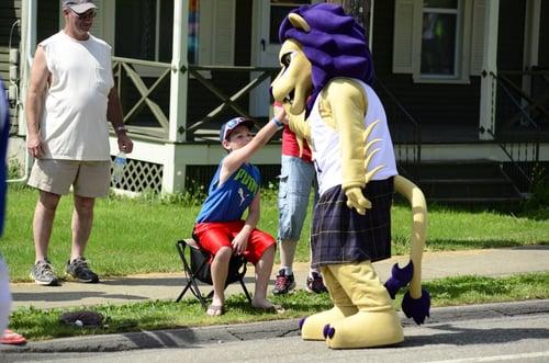 Houghton Highlander Custom Lion Mascot High Fiving a Fan