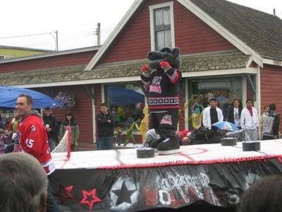 Hazelton Wolverine on hockey float in parade