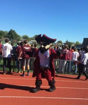 The Masked Marauder Mascot at the school's pep rally