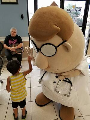 The Doctor mascot and his patients