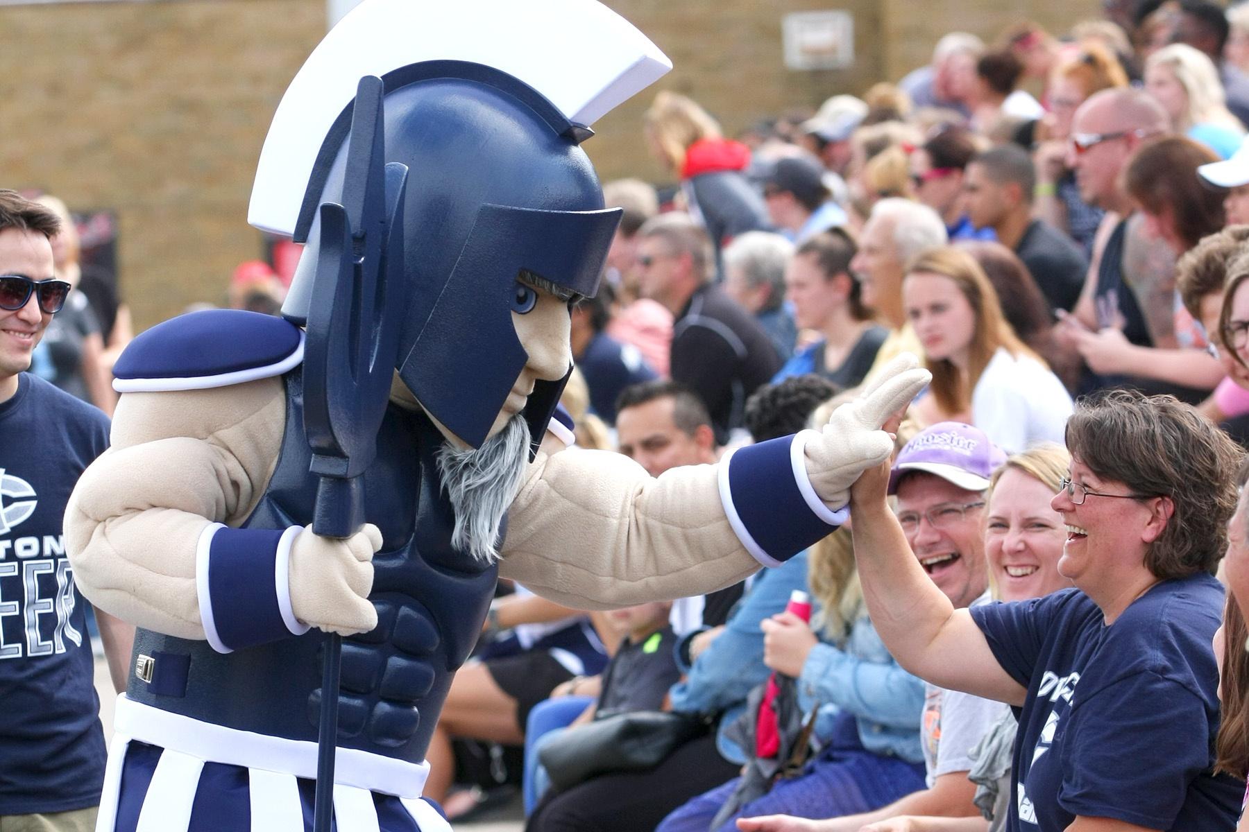 Iowa Central Community College Triton mascot high-diving a fan