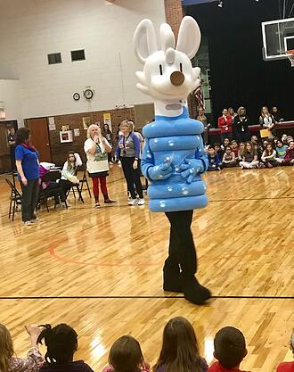 Oral Health Kansas Sippy mascot visiting a school