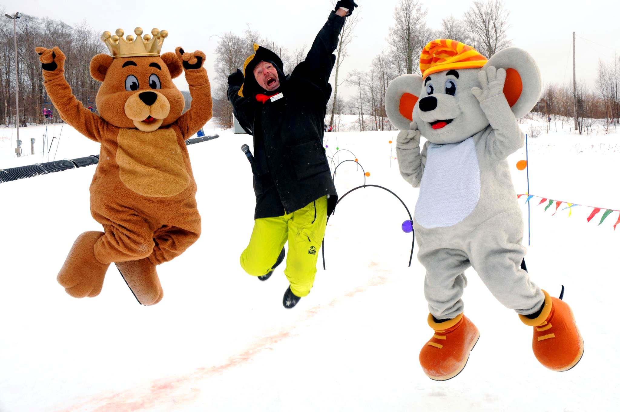 Two mascots jumping in the snow